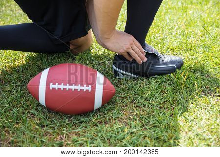 Elevated View Of American Football Player With Pain In His Ankle On Field