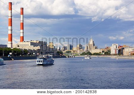 MOSCOW RUSSIA - July 23 2017. View of the building of the Foreign Ministry and the Moscow River. Berezhkovskaya (left) and Rostovskaya (right) embankments. Pleasure boats on the Moskva River
