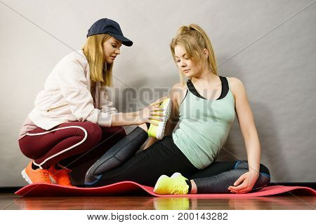 Woman In Sportswear Doing Workout With Trainer