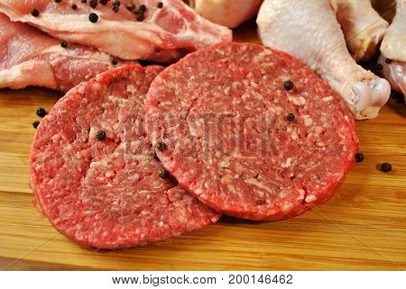 Two Raw Beef Burgers with Whole Peppercorns