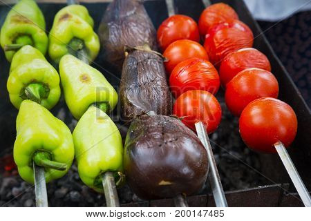 Fresh Vegetables On The Grill To Cook On A Metal Skewer. Tasty Tomatoes, Eggplant, Pepper Grilled On