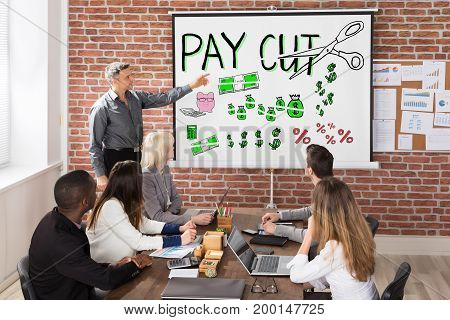 Man Giving Salary Paycut Presentation To Workers