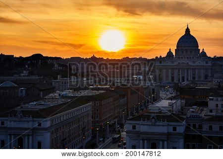 Rome silhouette at sunset with view on Vatican city.