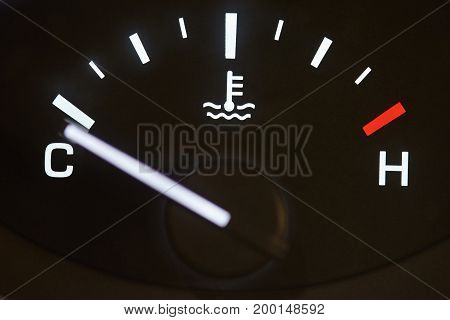 Car temperature coolant meter close-up. Temprature warning control