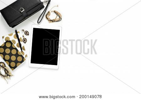 Flat Lay Photo Of Stylish Office White Desk With Wallet, Women's Jewelry, Tablet And Gold Notebook C