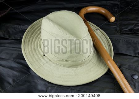 Bush hat and walking stick on a waxed outdoor jacket