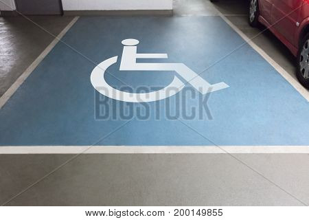 High angle view of handicap sign for parking in garage
