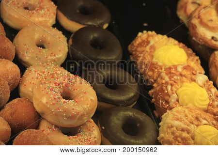 Fresh confectionery puff pastry with fruit and doughnuts