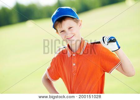 Boy golf player portrait with club