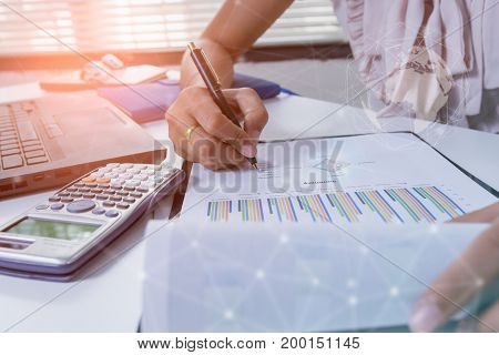 Double exposure business people working at office. Stock markets financial or Investment strategy background Business chart concept