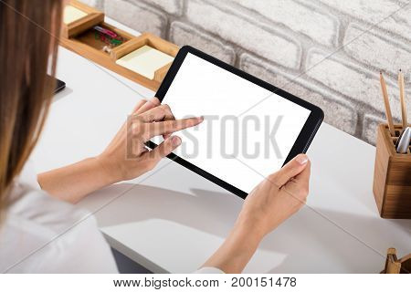 Close-up Of A Person's Hand Using Digital Tablet With Blank White Screen