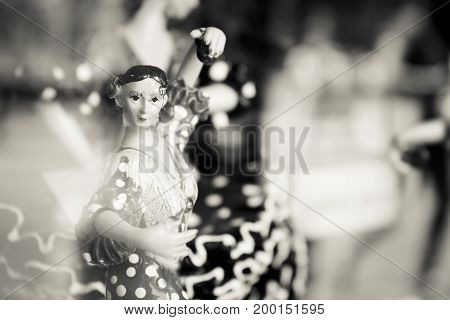 Mannequin of woman dancing sevillanas. Black and white
