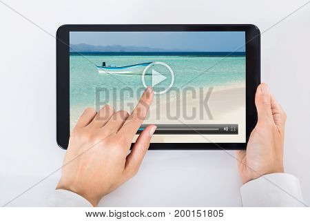 High Angle View Of A Person Watching Video On Digital Tablet