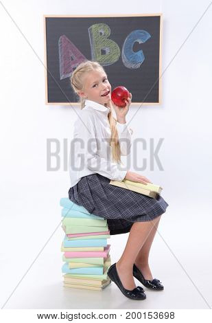 Cute girl with books in classroom
