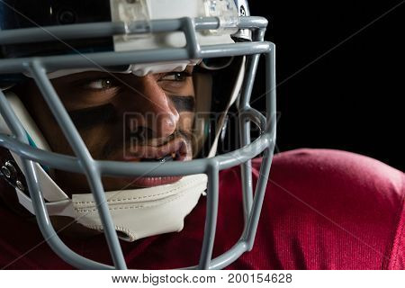 Close-up of determined American football player with a head gear