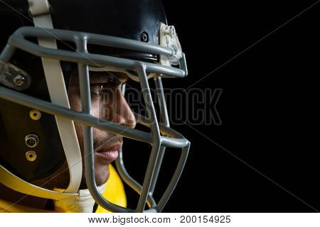 Close-up of American football player with a head gear