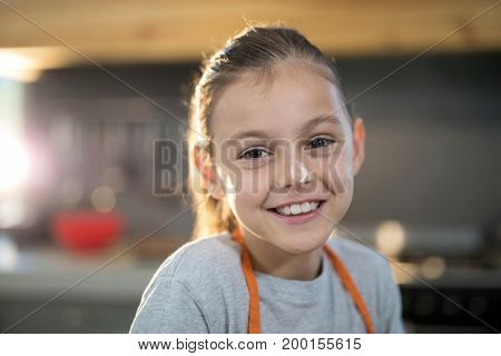 Close-up of smiling girl with flour on her nose