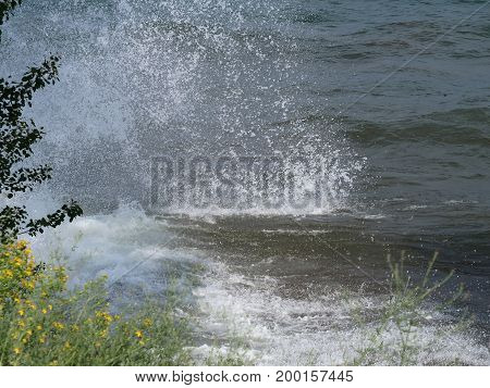 Choppy waters of Lake Superior typically come ashore with a mighty splash. Presque Isle Park Marquette Michigan.