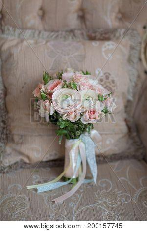 Elegant wedding flower bridal bouqet on texture sofa background