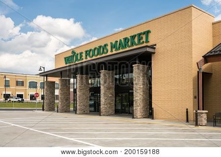 PITTSBURGH, PENNSYLVANIA, USA - AUGUST 17: Exterior of Whole Foods Market grocery supermarket on August 17, 2017 in Pittsburgh, PA.  The chain is being acquired by Amazon.com