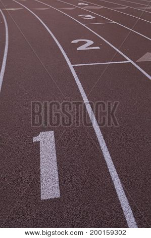 Starting line with numbers of a track for sprinting