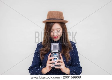 Beautiful young Asian woman with vintage style clothes and camera