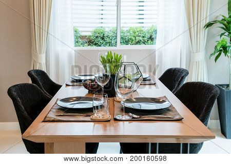 Wooden table and chair in modern dinning room at home. Interior of dinning room at home.