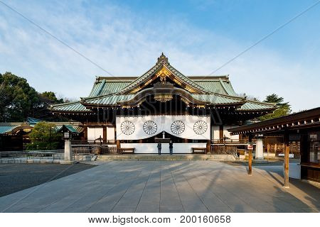 Japanese people praying at Yasukuni Shrine in Tokyo Japan. Yasukuni shrine is one of the most famous Tourist spot in Tokyo Japan