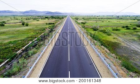 aerial view of a straight road in the valley