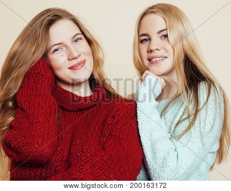 best friends teenage girls together having fun, posing emotional on white background, besties happy smiling, lifestyle real people concept close up. making selfie