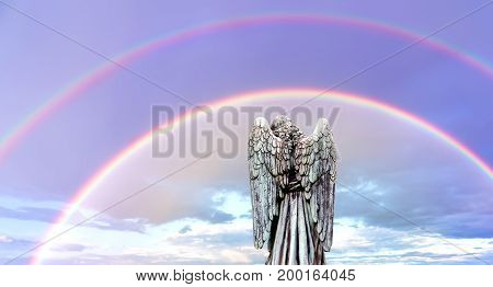 Angel with double rainbows gifts of encouragement and guidance from the other side
