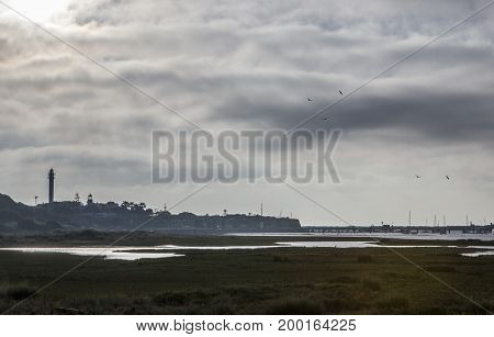 El Rompido lighthouse and marina at sunrise from marshlands Huelva Spain