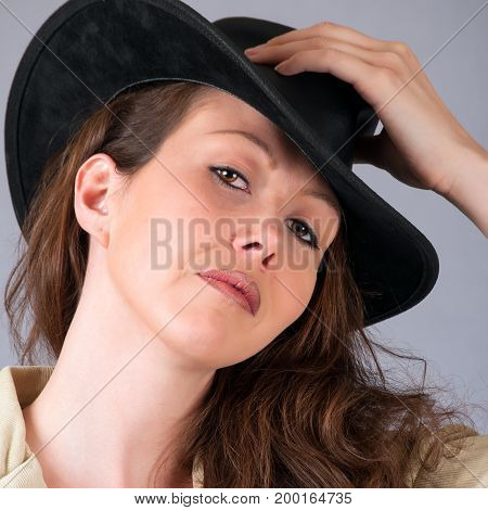 Attractive young woman wearing a cowboy hat for a portrait.