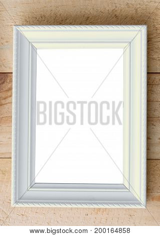 White picture frame with space on brown wooden wall background