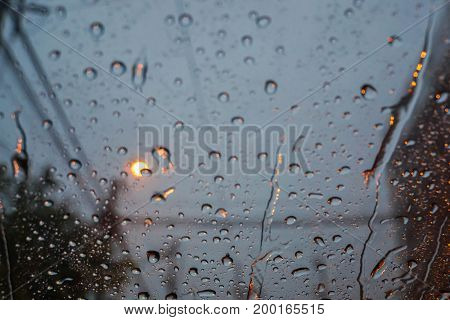 raindrops on the car windshield during rainy season