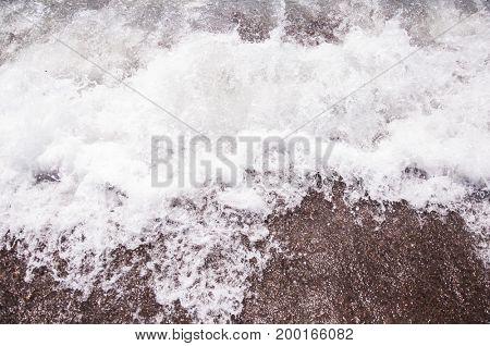 Wave on a pebble beach