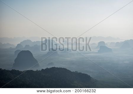 beautiful mountains layer in the morning mist for background Khao Ngon Nak or Dragon Crest mountain Krabi