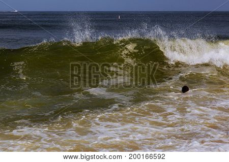 Drowning man trying to swim out of the ocean filtered man drowns in great waves in the ocean