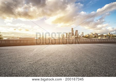 empty asphalt road with cityscape of los angeles