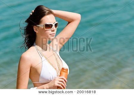 Summer Young Woman With Suncream In Bikini