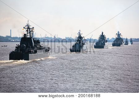 A line of modern russian military naval battleships warships in the row, northern fleet and baltic sea fleet in the open sea