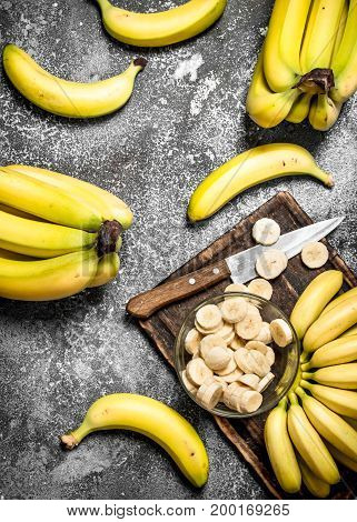 Fresh Bananas With Pieces Of Sliced Bananas In A Bowl.