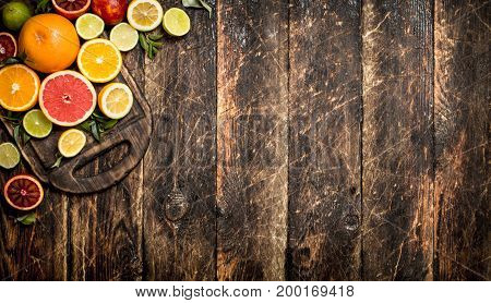 Citrus Background. Fresh Citrus Fruit On A Cutting Board.