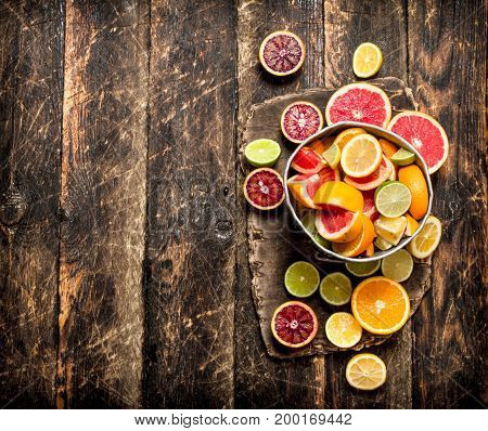 Citrus Background. Fresh Citrus Fruits In The Old Bucket.