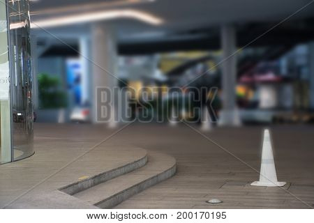 White traffic cone with blurred of community mall or shopping mall background ,Blurred of car park