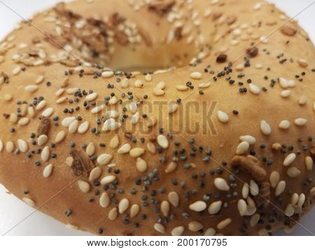 a bagel with onion and sesame seeds and poppy seeds