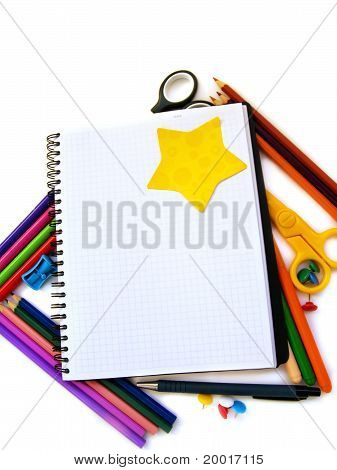 blank note book with school supplies