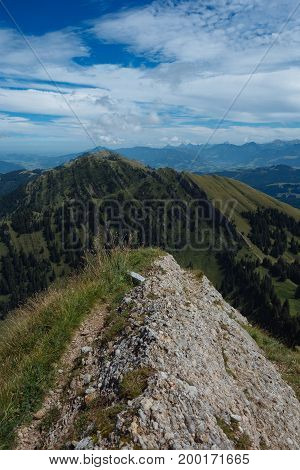 Hiking on the Nagelfluhkette in the German alps on a sunday afternoon