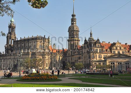 Dresden, Germany - September 2014: View to Hofkirche and Residenzschloss in Dresden's city center in September 2014, with people crossing the square in front