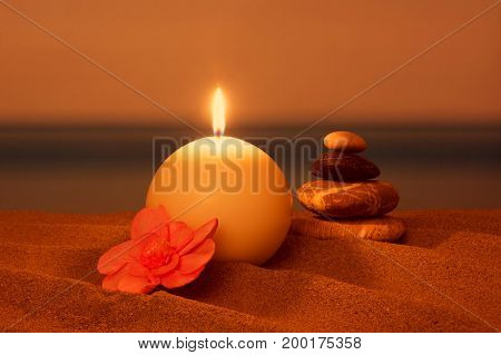 Candle on the beach relaxation concept, sea in summer